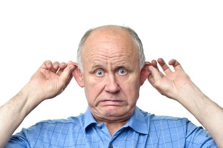 wondered: senior funny bald man is making grimaces Stock Photo