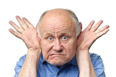 senior funny bald man is making grimaces Stock Photo