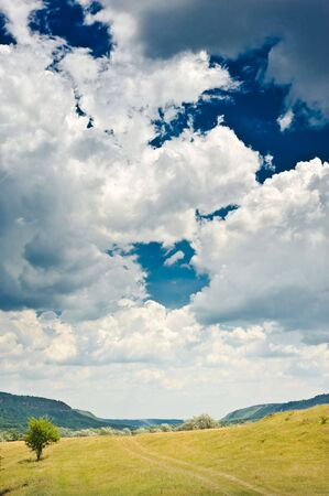 rural landscape with blue sky and clouds on it Stock Photo - 5186914