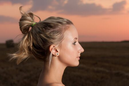 beautiful blond girl outdoor portrait at sunset photo