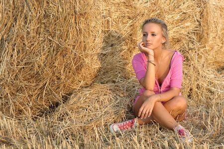 up country: portrait of pretty blond girl in light of sunset