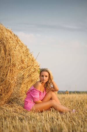 portrait of pretty blond girl in light of sunset photo