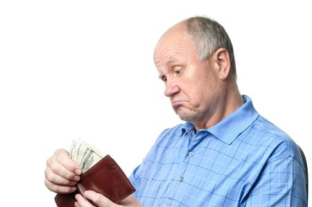 bald ugly: dissatisfied senior bald man is examining his cash savings