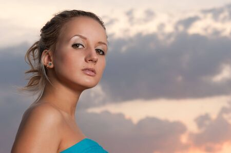 supercilious: beautiful blond girl outdoor portrait at sunset