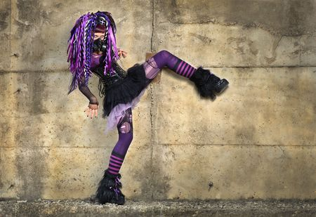 cyber gothic girl by the concrete wall