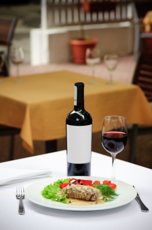 served: filletto al pepe verde and wine