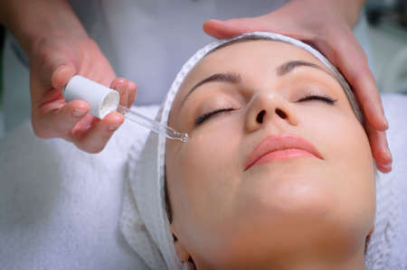 young pretty woman getting special skin treatment at beauty salon Stock Photo