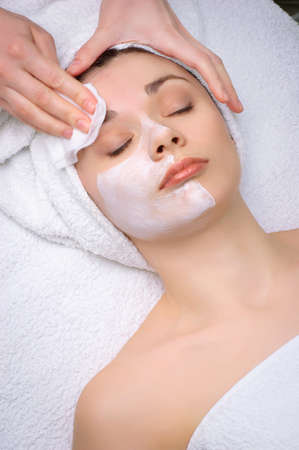 removing: beauty salon series. facial mask removing Stock Photo