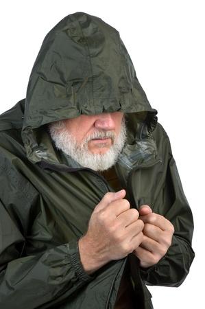 pathetic: pathetic senior man in green waterproof jacket