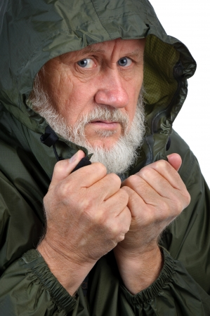 workless: pathetic senior man in green waterproof jacket
