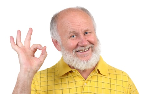 senior funny bald man in yellow t-shirt is shows gestures and grimaces Stock Photo - 11012676