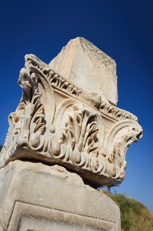 Corinthian capital, carved in marble at the top of pillar photo