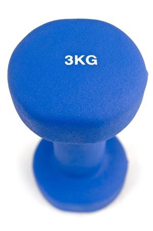 kg: 3 kg rubber dipped blue dumbbell, selective focus Stock Photo