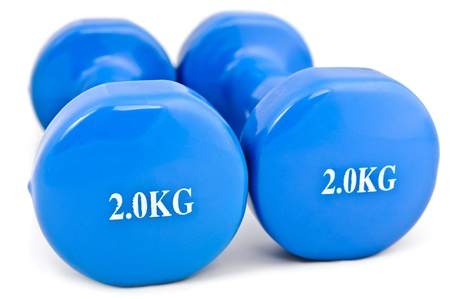 powerlifting: pair of 2 kg rubber dipped blue dumbbell, selective focus
