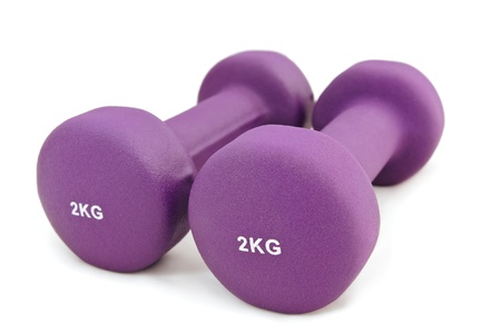 kg: 2 kg rubber dipped purple dumbbell, selective focus Stock Photo