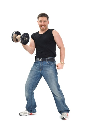 man staying with dumbbell and smiling, on white background photo
