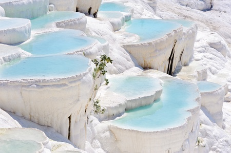 Blue cyan water travertine pools at ancient Hierapolis, now Pamukkale, Turkey Stock Photo