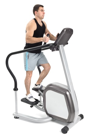 one man doing step machine exercise, on white background photo
