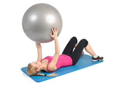 Female lying abs crunching exercise with fitness ball. position 1 of 2. Stock Photo - 12234612