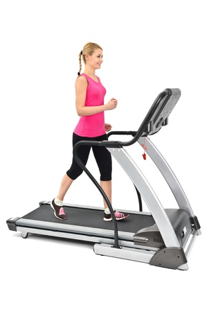 young woman doing exercises on treadmill, on white background photo
