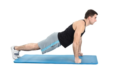 deltoids: young man performing push-ups exercise on fists, on white background Stock Photo