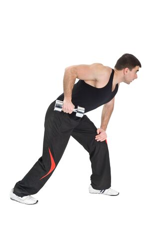 triceps: Young man doing Standing Dumbbell One Arm Triceps Extensions on Fitnes Ball, phase 2 of 2.