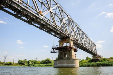 Old abandoned railroad bridge across the Dniester near Ribnita, Moldova