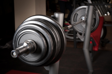 powerlifting: Barbell ready to workout, indooors, shallow DOF Stock Photo