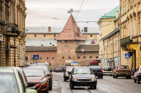 armory: Street view of modern Lviv with old Armory, Ukraine Editorial
