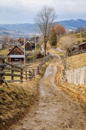 Dirty road in Carpathian village Vorokhta in the Ukraine