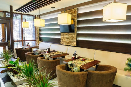 Modern restaurant inter with tables and sofas Stock Photo - 25108170