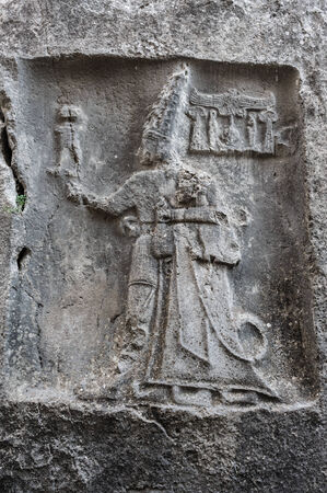 dated: Rock carving in Yazilikaya depicting god Sharruma and King Tudhaliya dated to around 1250 - 1220 BC  Editorial