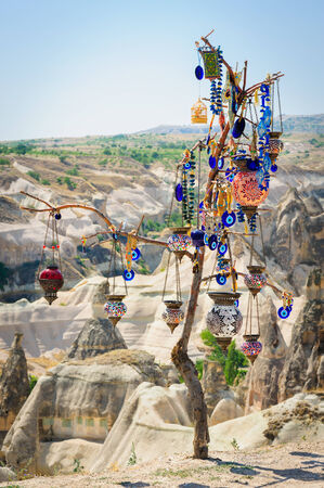 souvenirs: Turkish souvenirs hanging on dry tree in Cappadocia