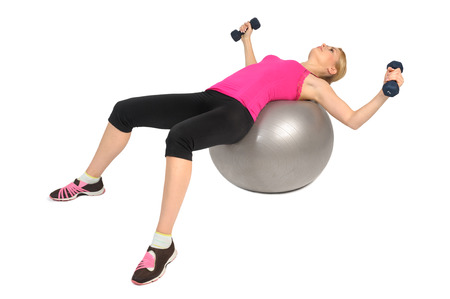 woman chest: Woman with Dumbbell exercise on Stability Fitness Ball Exercise