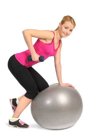 powerlifting: Woman with Dumbbell exercise on Stability Fitness Ball Exercise, phase 1 of 2