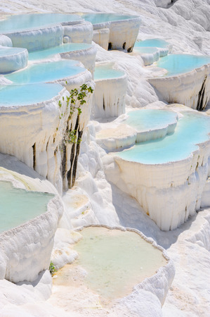 basin mountain: Blue cyan water travertine pools at ancient Hierapolis, now Pamukkale, Turkey Stock Photo