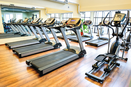 Set of treadmills staying in line in the gym