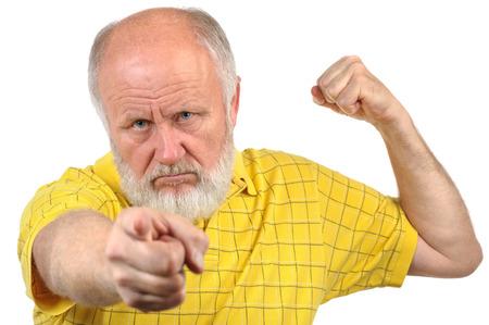 menacing: menacing senior bald man in yellow shirt
