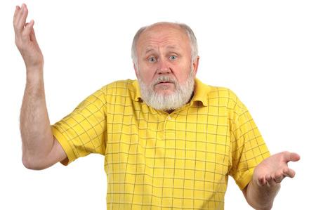 senior bald man in yellow shirt shows disturbance
