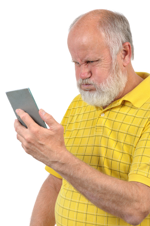 puffed cheeks: senior bald man wih puffed up cheeks looks into mirror