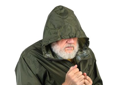 workless: pathetic senior man in green waterproof jacket