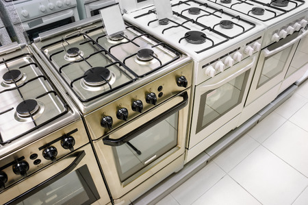 rows of gas stoves selling in home appliance store