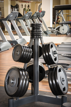 discs: Barbell plates holder rack in the gym