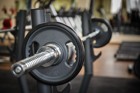 gym equipment: Barbell ready to workout, indooors, shallow DOF Stock Photo