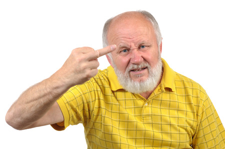 nasty: senior bald man shows fuck with middle finger, motion blur at hand