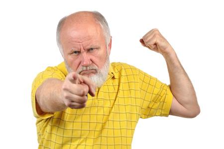 yellow shirt: menacing senior bald man in yellow shirt