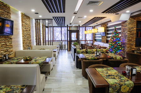 Modern restaurant interior with tables and sofas photo