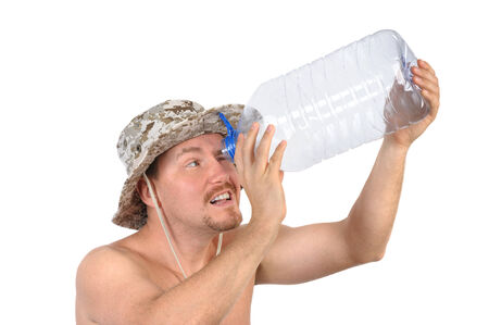 young bearded man looking into empty plastic bottle photo