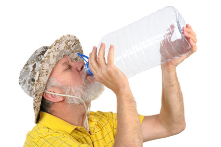 old man beard: senior balding bearded man holding empty plastic bottle Stock Photo
