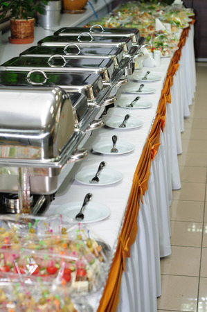 chafing dish: chafing dish heaters at the banquet table